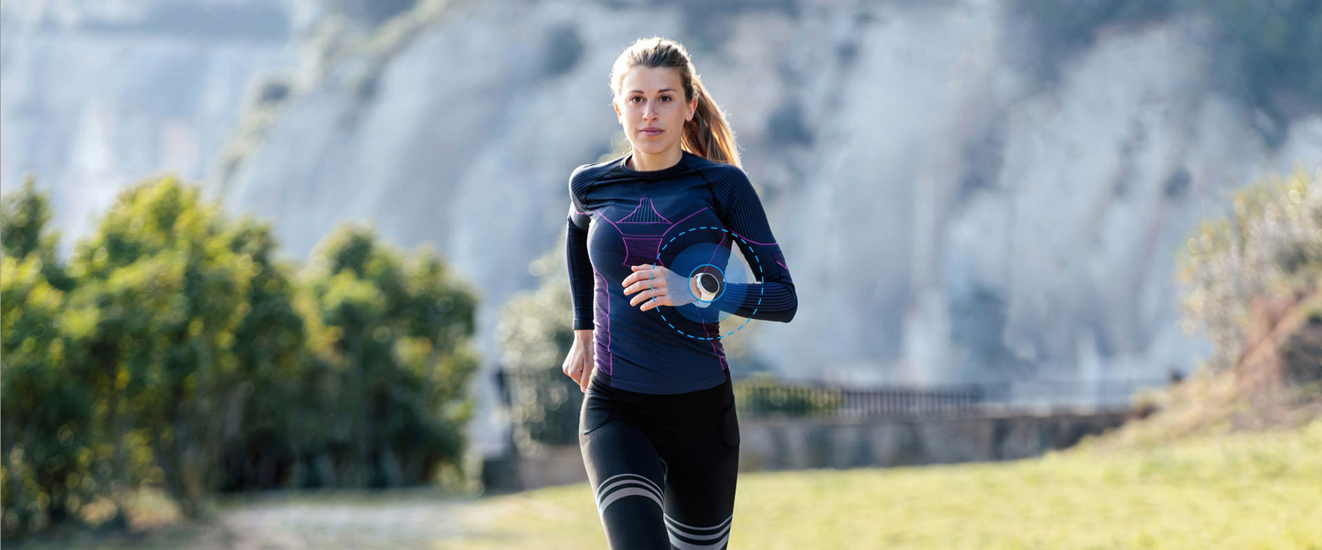 Woman running with a GPS watch